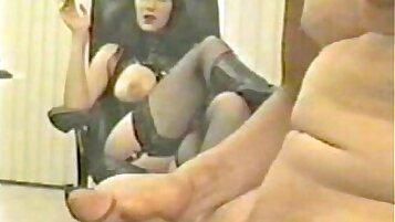 Big black art femdom touching a dick