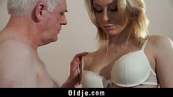 Blonde interview and dude making a pill for her feet